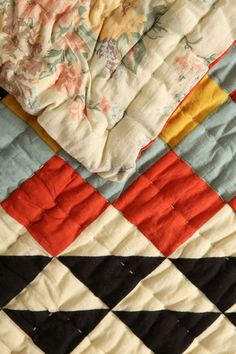 Hand quilted half-square triangle solids quilt