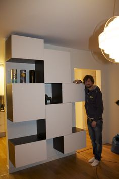 Ikea Besta storage - something like this in the family room .