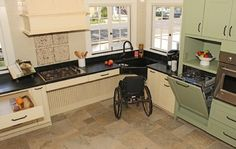 Space under the corner sink and cabinets accommodates a wheelchair, while the slightly raised dishwasher makes loading and unloading dishes easier for everyone.  (Cabinets by Design)