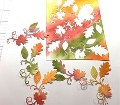 one photo tutorial shows how to get gorgeous watercolor blends onto delicated die cut leaves and flourishes ...