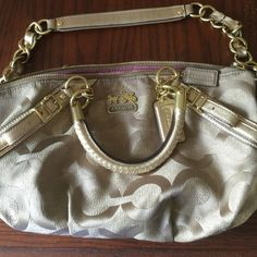 "Coach ""Ashley"" handbag Beautiful gold color with gold colored hardware. Cell phone pocket plus 2 more pockets. Small ink mark on inside. Measures 7.5"" x 13.5"" x 5"". Coach Bags"
