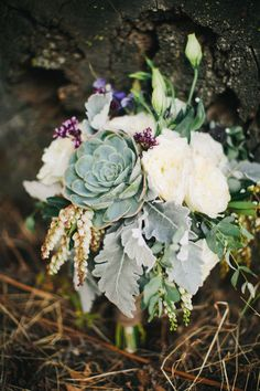 Bouquet of ivory garden roses, succulents & petite purple blooms | Free-Spirited Cle Elum Ranch Wedding With Vintage Detailing | Photograph by Ryan Flynn Photography  http://storyboardwedding.com/free-spirited-cle-elum-ranch-wedding-vintage/