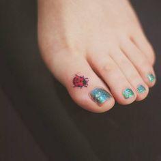 Little Tattoos — Small ladybug tattoo on the toe. Tattoo artist:...