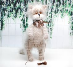 This gorgeous kitty is hand knitted from amazing mohair wool yarn! It is very fuzzy and very soft. Kitty is tall, slim, proud and beautiful! Kitty can stand without support. The kitty is 8 x 2 x 4 It was created in non smoking environment. It will arrive to you packed in a gift bag. Fast domestic shipping!  PLEASE NOTE, TOY IS NOT SUITABLE FOR SMALL CHILDREN. RECOMMENDED AGE 5+  Welcome to Fuzzoo. You will find little cute amigurumi toys here, as well beautiful dolls for kids. Fuzzy…