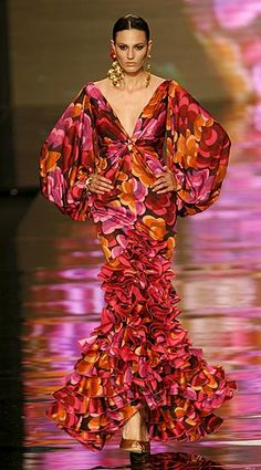 A model presents a creation from Vicky Martin Berrocal during the International Flamenco Fashion Show in Seville January The show will run until February ☆☆ Colorful Fashion, Love Fashion, Fashion Show, Fashion Design, Gipsy Fashion, Fashion Themes, Fashion Dresses, Prom Dress Couture, Estilo Hippy