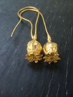 Gold Poppy Pods - could do something like this with electroforming