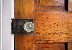 An upstairs door shows the beauty of its age in an 1892 home in the Broad Ripple neighborhood of Indianapolis. (Frank Espich/The Star)
