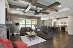 The coffered ceiling looks amazing in this gorgeous living room.