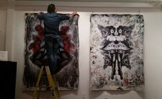 Cass Fuller installing his work at the gallery.