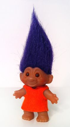 troll doll - I remember making clothes for mine with felt and little sew on pearls for the closure. Probably why I sew to this day!
