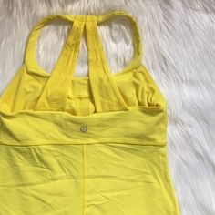 Lululemon Scoop Me Up Tank In gently used condition. Has a built in shelf bra but cup inserts will not be included. No size dot. lululemon athletica Tops