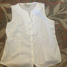 New with tags's loft shirt. Ann Taylor loft sleeveless blouse. New with tags's, a petite large. Has ruffles and button down LOFT Tops Tank Tops