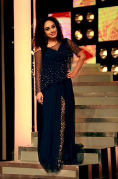 Pearle maaney in midnight blue cape gown for eastern D3. costume by pranaah