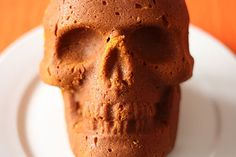 Skull shaped pumpkin spice cake.  Great party desert, possibly could also use the mold to form dips into shape.
