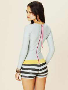 C. Style- I love this rash guard, one piece surf suit from Free People