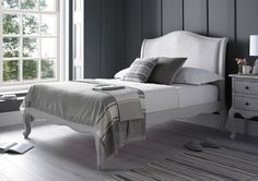 The Emily bed frame is inspired by classic French design and features subtle carving details and an attractive upholstered headboard. Finished in a warm grey lightly distressed paint finish, the Emily will create a warm and sophisticated look in your bedroom. The Emily comes complete with a traditional wooden slatted base system, and the design will work well in both modern and more classical design schemes.