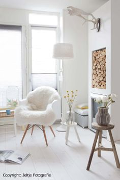 Modern room but its the texture that sets it off from the inset wood stack, antlers, fur throw—just perfection