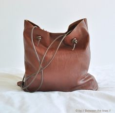 I just finished another leather bag this afternoon and I love it.  As a matter of fact, I just put it to the test and I find it perfect ...