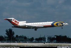 727 In TWA colors sporting a St. Louis Ram's helmet special livery. St. Louis, Missouri was one of TWA's hubs and the Rams' current home used to be called Trans World Dome after TWA. - Trans World Airlines