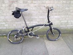 """Jon's custom Brompton: """"I've finally finished the last bout of daft blinging which I thought I'd share. In total that's a new bottom bracket, cranks, chain, clamps, rims, spokes, cables, brake levers, carbon bars, bar ends and mudguards and the best bit – the new SA 5 speed hub which is totally ace. Major improvement on the 3 speed. And enjoyed doing the work myself at the fabulous London Bike Kitchen, where you get advice and all the tools. Pretty much only original ..."""