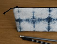 You can use this zipper pouch as a pencil case or a cosmetic bag. 100% handmade. 100% cotton. White Tea Mugs, Shibori Techniques, Black Tie Dye, Pencil Cases, Bag Design, Cotton Bag, Zipper Pouch, Cosmetic Bag, Sunglasses Case