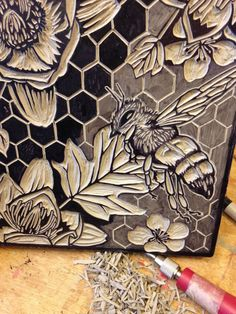 The Bees Blessing is a lovingly designed linocut....