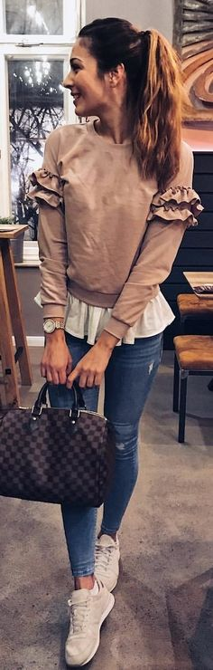 #winter #outfits brown long-sleeved top and distressed blue jeans