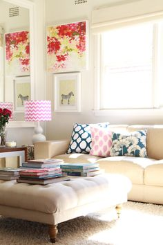 Sunny and bright. Love the ottoman in place of a coffee table.
