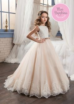 The Yonkers is an adorable gown with a train for an extraordinary wedding. The dress features a bateau neckline with sequin embellished bodice. The contrasting colored skirt features layers of gathere