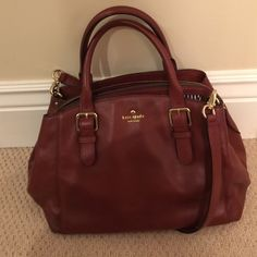 Kate spade chocolate brown tote Multi compartments-- you can carry so much inside! Has shoulder strap and carry handle. Beautiful and in fantastic condition, no signs of wear. kate spade Bags Totes