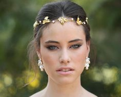 Perfect for the Bohemian style bride, a handmade 24K gold plated headpiece is like a golden floral crown encrusted with pearls. Romantic with a