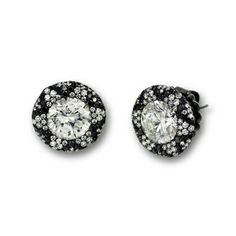 Starburst Black and White Diamond Stud Earrings 3.03 carats surrounded by a micro-set starburst border of black and white diamonds, 1.30 total carat weight. Antiqued 18K white gold setting. #diamonds #earrings #martinkatz #jewels #vintage #blackdiamond
