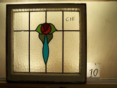 Brilliant English all textured Mackintosh rose stained glass window in original frame. $89.00, via Etsy.