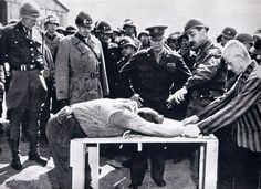 Gen. Eisenhower being informed of cruelties at concentration camps.  Gen. Patton is at far left.