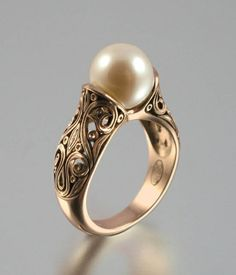 Vintage Rings Gold Pearl Ring A genuine gold pearl. Set in oxidized silver. Stunning Pearl Ring Gold as 1576 Vintage Pearl And Diamond Engagement Rings Pearl Jewelry, Gold Jewelry, Jewelry Box, Jewelery, Vintage Jewelry, Jewelry Accessories, Fine Jewelry, Sapphire Jewelry, Pandora Jewelry