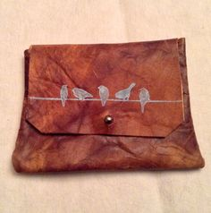 Brown leather pouch with birds on a wire print on Etsy, $15.00