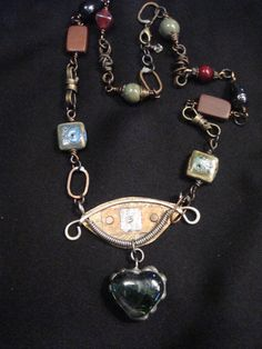 Handmade OOAK necklace qith wired wraped metal by RockledgeStudios