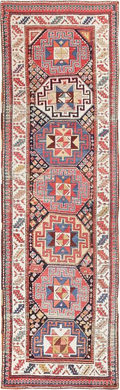 Here is a remarkable antique Oriental rug - an antique Kuba runner, woven by the great tribal rug-makers of the Caucasus