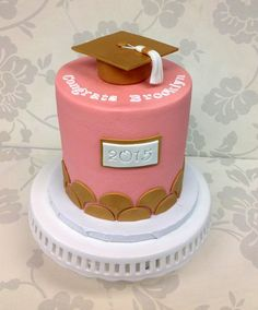 Pink and gold graduation cake from The Cupcake Shoppe in Raleigh.