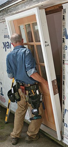 "In this ""Building Skills"" article, senior editor Andy Engel describes how to install a prehung exterior door. To start, he checks the wall and sill for level, and installs shims as needed. Then, after placing beads of sealant across the length of the rough sill, he sets the door in the opening. Driving one screw through the door trim near the top hinge keeps the unit from toppling while it's being shimmed plumb. Next, after shimming them, Engel fastens the hinges to the framing...."