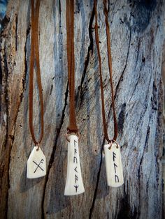 Viking Rune Pendant Necklaces Hand carved into polished bone to serve as amulets for various reasons: good luck, fertility and ale. The bone is cow, strand is leather. Check them out in my ETSY...