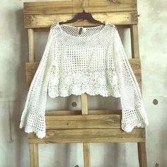 H&M bell sleeve crochet crop top size L Never been worn - size L from H&M Divided, bell sleeves, color is a very light cream/off white H&M Tops Crop Tops