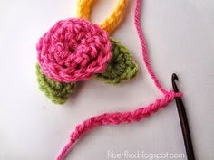 Here are some sweet little roses you can crochet in just a few minutes. They look cute sewn on just about everything, perhaps a whol...