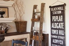 really like the writing on the ladder(do on mine in family room)also piece of burch trunk, shelving, subway art sign...