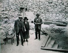 Lord Carnarvon's first visit to the Valley of the King's: Lord Carnarvon (1866-1923), Lady Evelyn Herbert, his daughter and Howard Carter (1874-1939) at the entrance to the Tomb of Tutankhamun, 1922