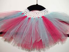 "This double-layered tutu would look so cute on your ""Little Gift Frm Heaven,"" a very soft and angelic piece created of the softest tulle. Perfect for photo-ops or anytime you just want to show her off. Colors can be customized to your preference: coral, white, ivory, turquoise, coral, red, & green.  Littlegiftsfrmheaven.etsy.com"