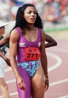 """suchaloverandfighter: """" introvertedwomanistmusings: """" """" …and Flo-Jo """" Flojo was so FLY. """" I did a Black History report on Flo Jo in elementary school. Flo Jo, Empire State Building, Jackie Joyner Kersee, I Love To Run, Long Jump, Sport Icon, Black Girl Fashion, Sports Photos, Summer Olympics"""