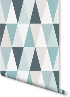 After the Scandi look in your home? This geometric wallpaper design features a subtle yet versatile colour palette. Featuring a calming tonal range between blue and green, it's perfect for modern living room spaces and kitchens.
