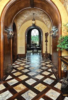 Mediterranian arched entry- Marble tiles interlaced with wood. Magical floor....