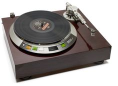 Denon DP-62L. It has an electronic Q damping arm. It is direct drive with AC servo motor.